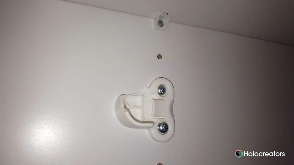 Broken IKEA clothing rail holder in closet