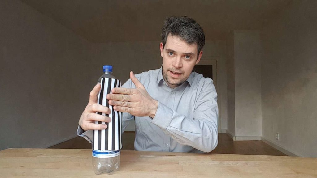 Swann Rack explains structured-light 3D scanner with a fringe pattern on a water bottle